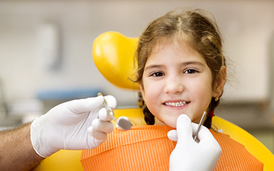 Little girl in dental chair