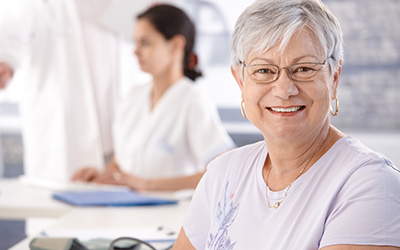Mature woman in dental office
