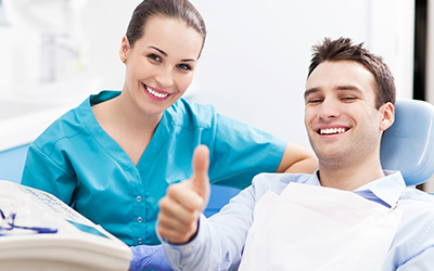 Dental impant patient with thumbs up